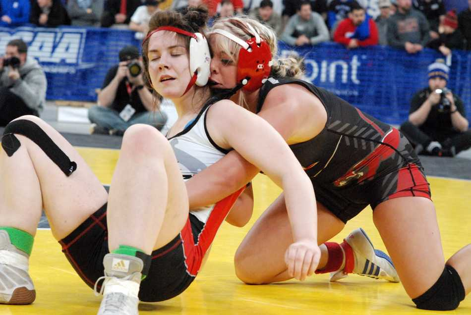 Taylor Ohlson (right) controls Thurston's Lindsay Burrell. Ohlson won the 135 title but Thurston took the team title