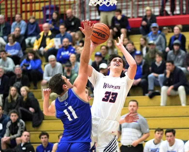 Westview's Brady Grier (33) shoots over Grants Pass' Chase Coyle on Wednesday night. (Photo by Jon Olson)