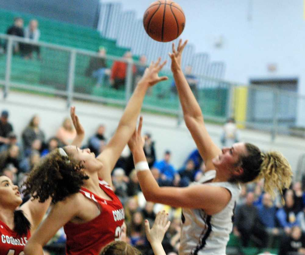 Kennedy forward Sophia Carley puts up a shot over Coquille star Morgan Baird. The Kennedy star scored a game-high 23 points.