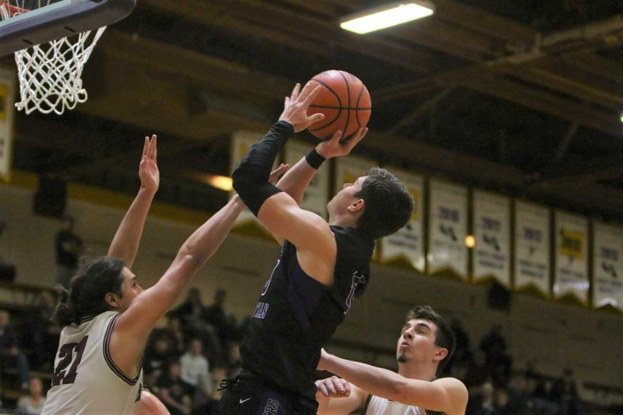 Cascade Christian's Keegan Schaan goes up for a shot against Dayton on Thursday night. (NW Sports Photography)