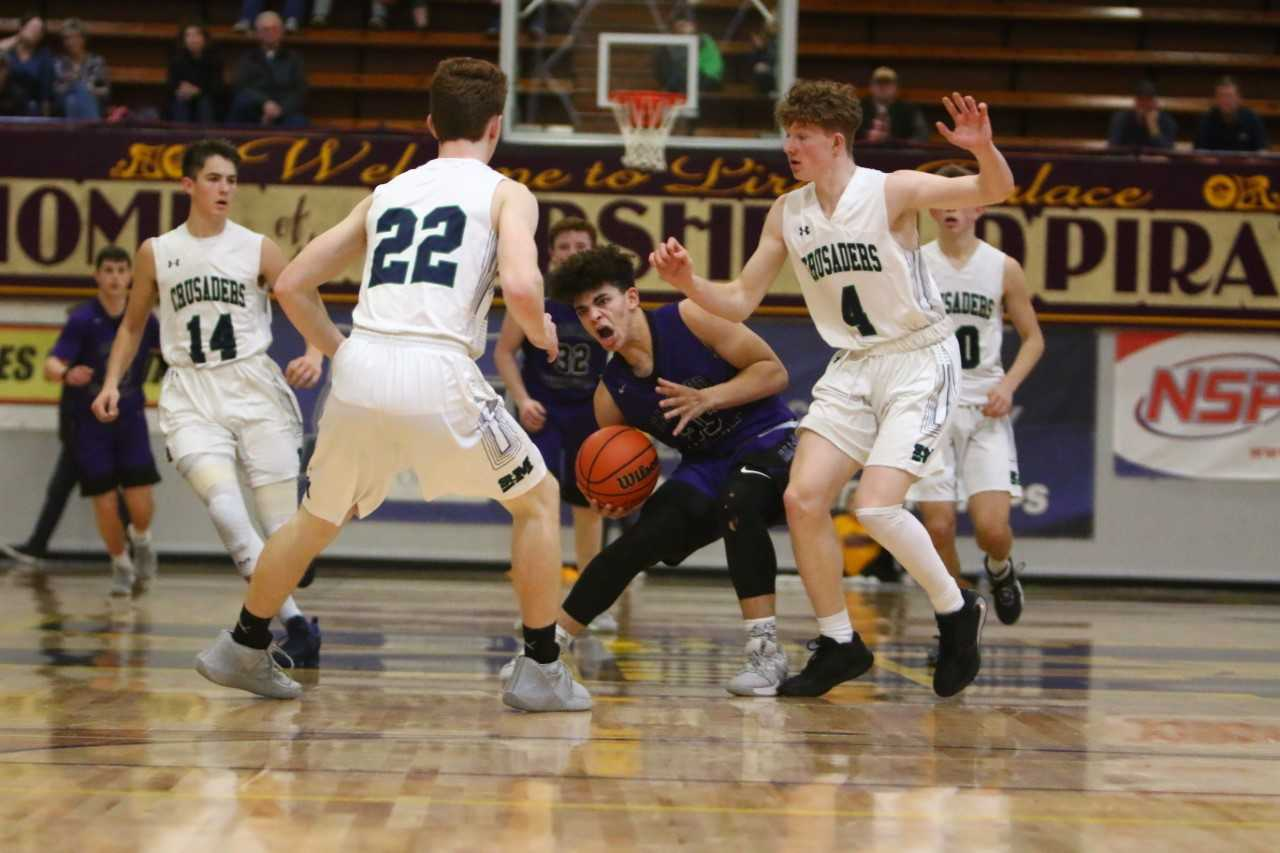 Cascade Christian's Donminic Lewis (center) scored 22 points against St. Mary's. (NW Sports Photography)