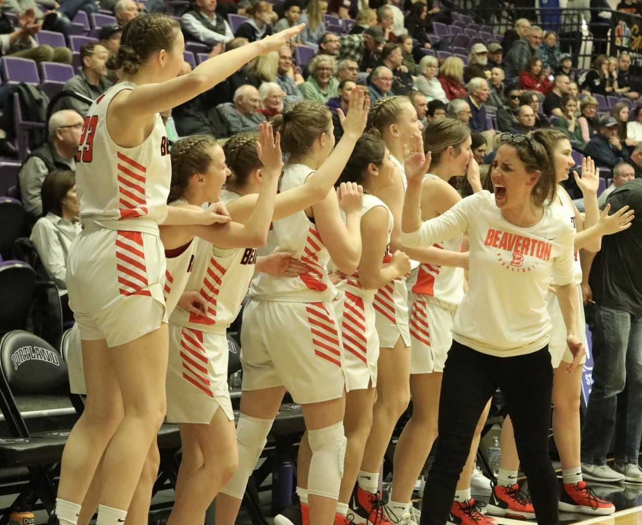 Beaverton coach Kathy Naro celebrates Wednesday's win over Southridge with her players. (Photo by Norm Maves Jr.)