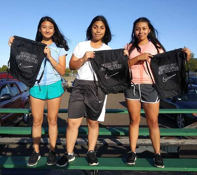 Parkrose runners (left to right) Michelle Nuyen, Rachel Vergara and Vivian Varela received Nike gear from the OSAA Foundation.