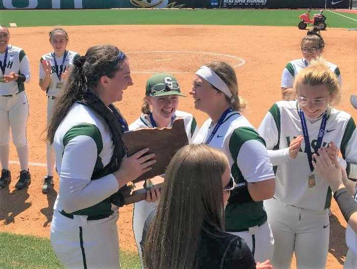 Sheldon softball players celebrate after winning the 6A title last year.