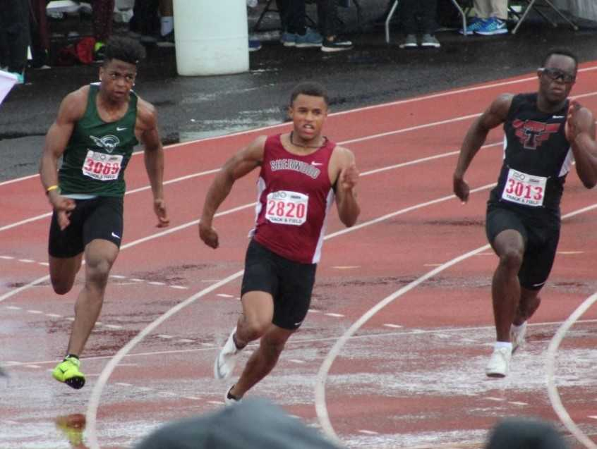 Sherwood's Caleb Hagan (center) won the 100 and 200 meters in the 6A meet last year. (Photo courtesy Sherwood HS)