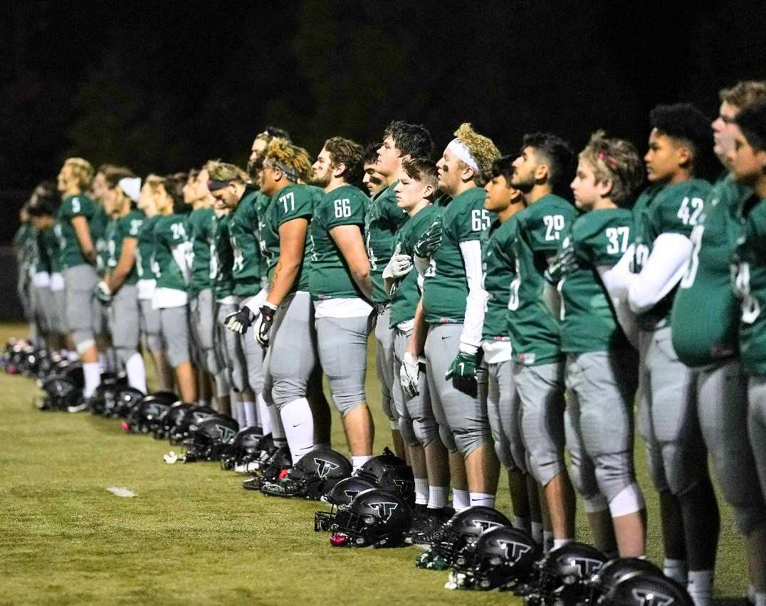 Tigard football players prepare to take on district rival Tualatin last season. (Photo by Jon Olson)