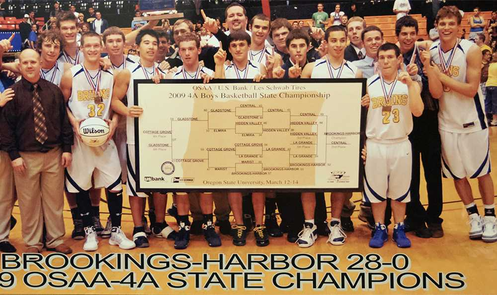 Fred Corpening (far right), who grew into a basketball star, celebrates the 2009 state title with his Bruin teammates