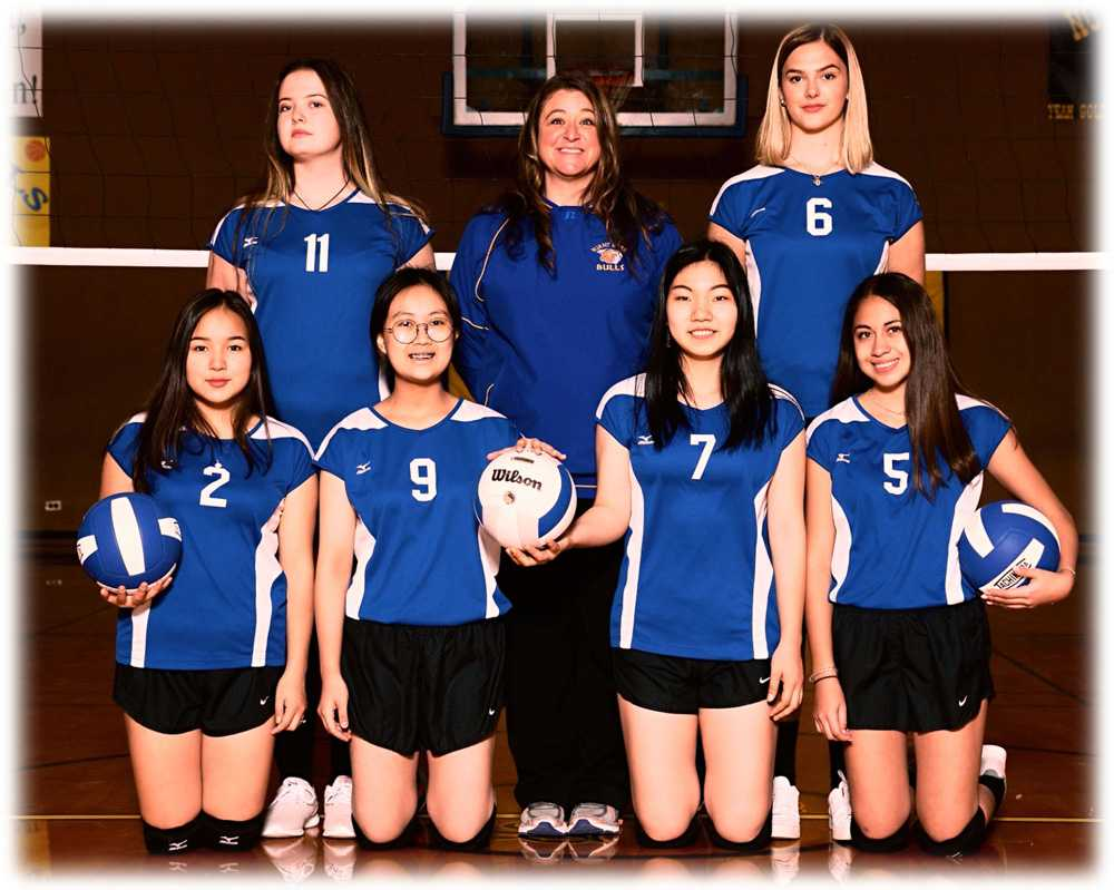 Burnt River coach Tonia Humbert is flanked by last year's international volleyball team
