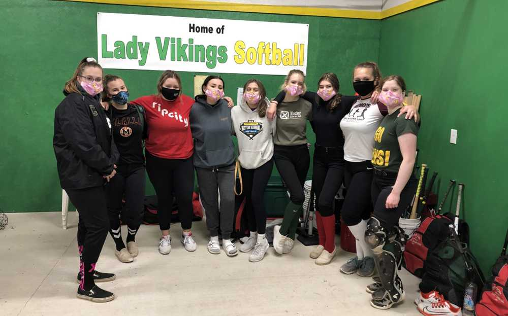 The Colton softball team poses in the new hitting facility made possible by community parents and volunteers