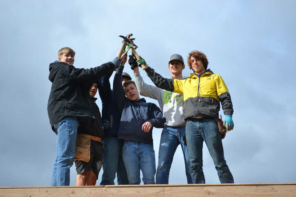Crosshill Christian's senior soccer players used their hammers to nail a service project to benefit wildfire victims