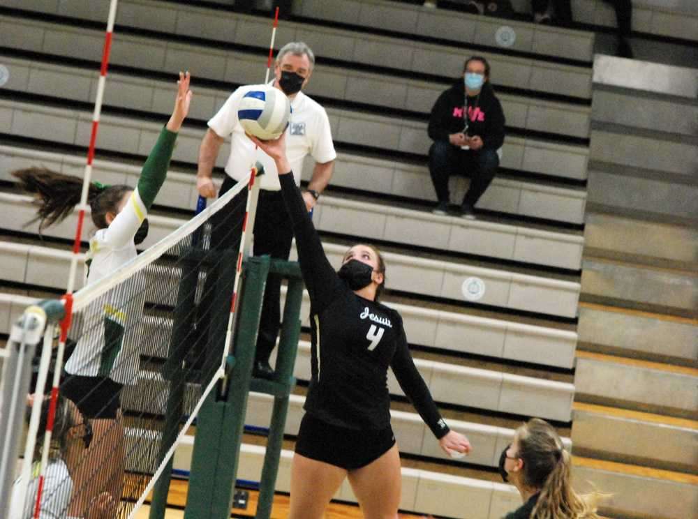 This set from Alison Buchholz in the third set helped break open a tie game on the way to Jesuit's sweep