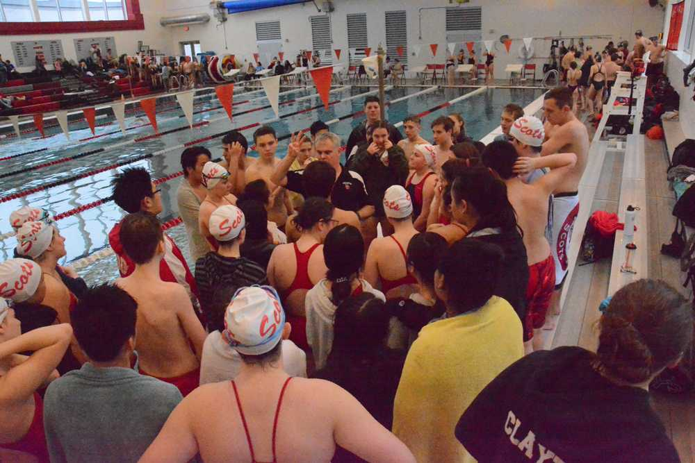 Jim Bowe talks to his swimmers inside the new aquatic facility at David Douglas HS