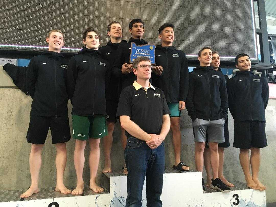 Bryan Butcher has led Jesuit's boys swim team to six consecutive 6A titles.
