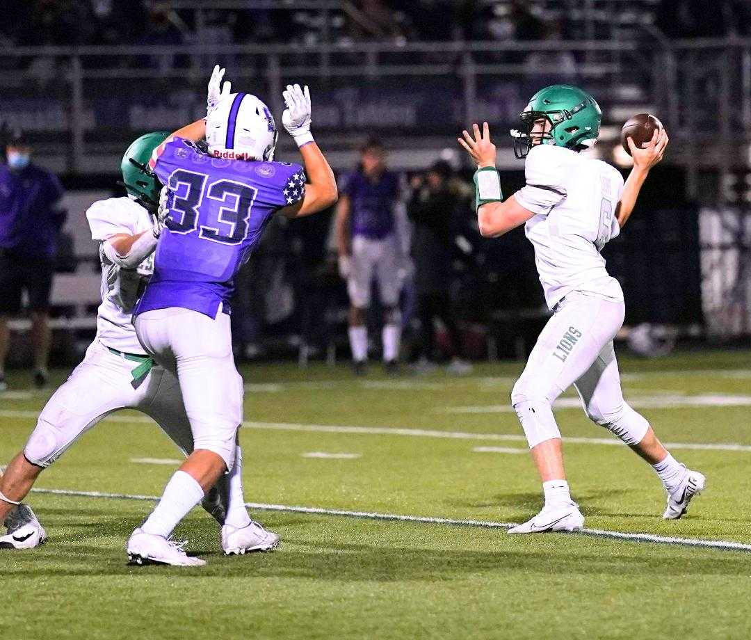 West Linn's Chase Harmon threw for 268 yards and three touchdowns Friday at Sunset. (Photo by Jon Olson)