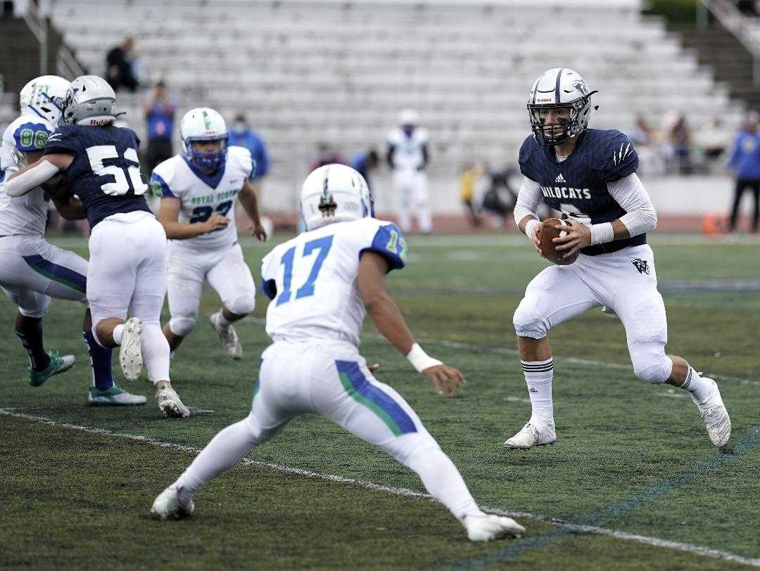 Wilsonville's Chase Hix had three touchdown passes Saturday, giving him nine in three games. (Photo by Jon Olson)