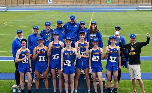 Siuslaw's boys and girls celebrate winning Northwest Classic team titles Saturday in Eugene. (Photo by Becky Holbrook)