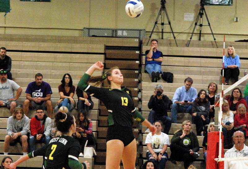 Sophomore Makayla Long unloads for No. 4 West Linn in its opener versus Grants Pass