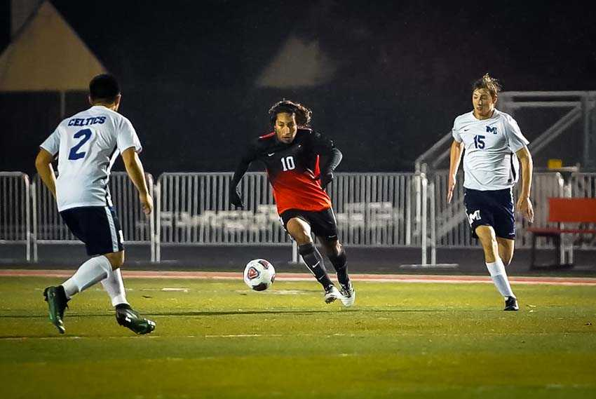 Josh Rubio presses the attack for Beaverton in its 3-1 win over McNary. (Photo by Jason Sarmiento)