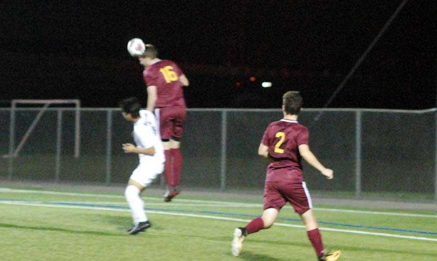 Central Catholic's Fritz Kabeiseman goes high to clear a cross in a losing effort to 17th-seeded Aloha