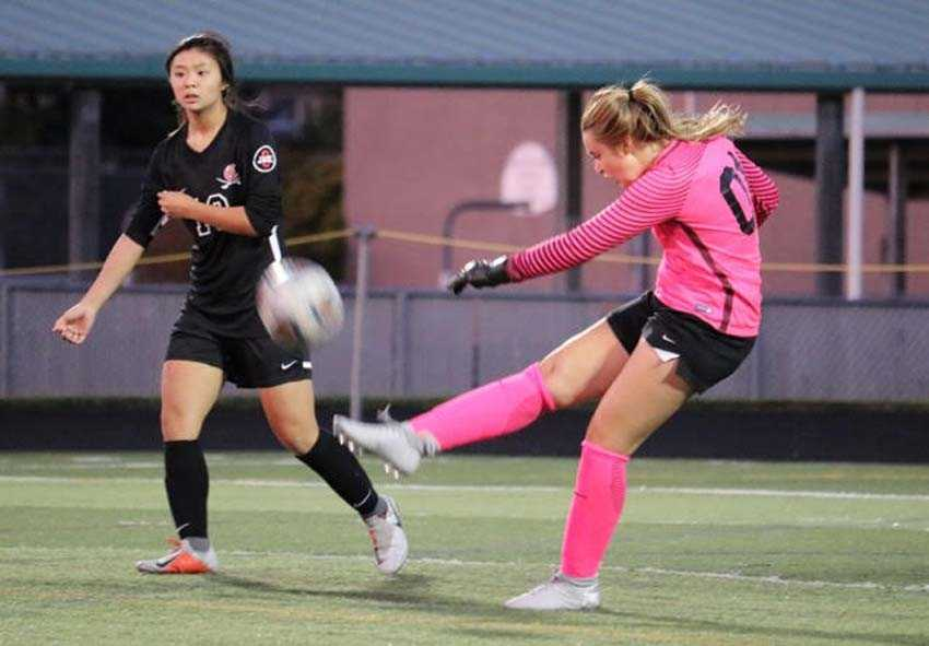 Clackamas goalie Hallie Byzewski punts the ball away while Remie Le looks on in an older photo captured by Amber Cordry-Martinez