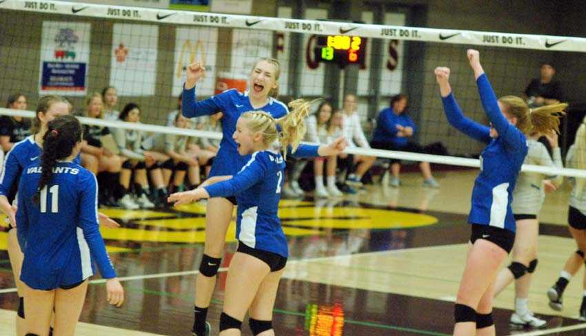 Valley Catholic celebrates a big win over La Grande on Friday afternoon