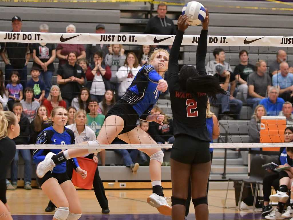 St. Paul's Isabelle Wyss, hitting against North Douglas, had 21 kills against Powder Valley. (Photo by Andre Panse)