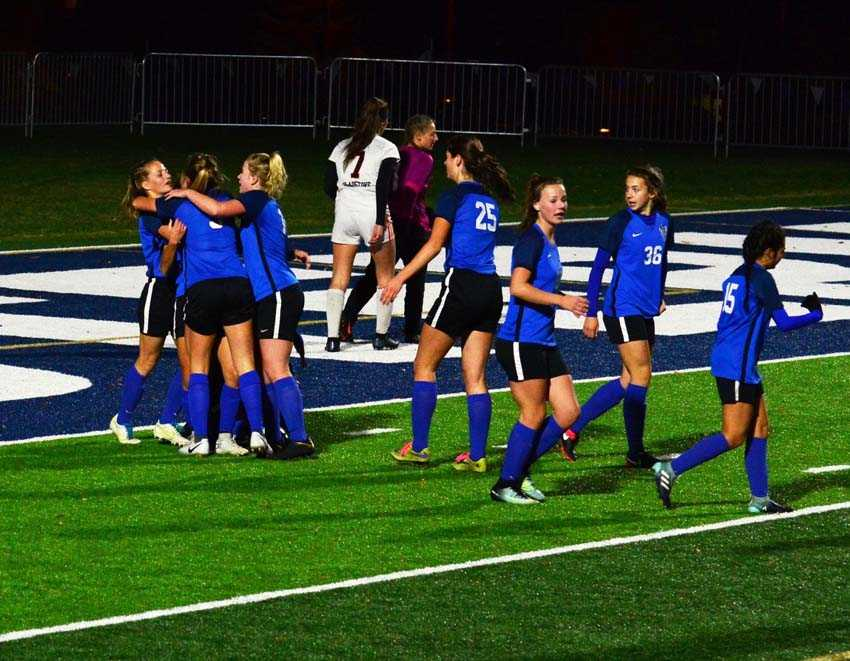 The La Grande Tigers celebrate the tying goal in yesterday's one-goal win over Gladstone