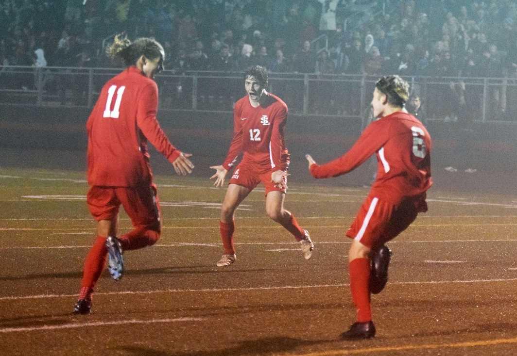La Salle Prep's Luke Strange (11), Kainoa Taylor (12) and Karter Cook (6) celebrate the winning goal. (Photo by Lauren Craven)