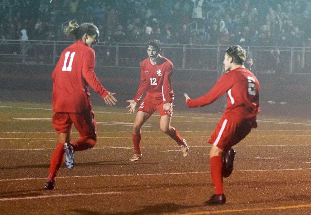 La Salle Prep's Luke Strange (11), Kainoa Taylor (12) and Karter Cook (6) celebrate the winning goal. (Photo by Lauren Craven)