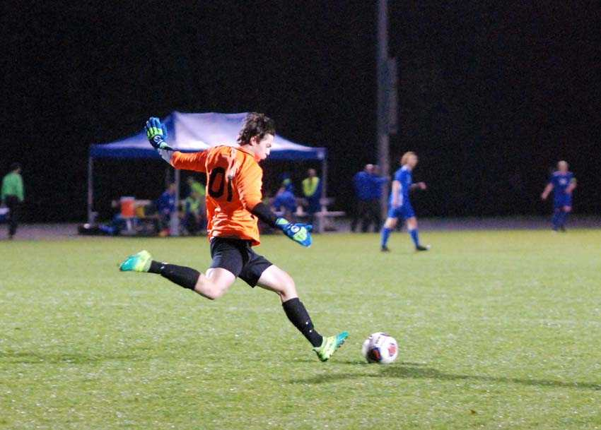 Catlin Gabel boys soccer goalie Bowen Blair booms a goal kick