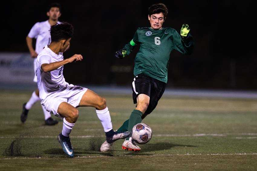 Simon Kidder dribbles for Summit against the challenge of David Douglas' Gustavo Perez. (Photo by Rob Kerr)