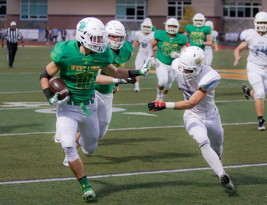 West Linn's Brodie Corrigan scored three touchdowns in a 45-28 win over Lakeridge on Sept. 21. (Photo by Brad Cantor)