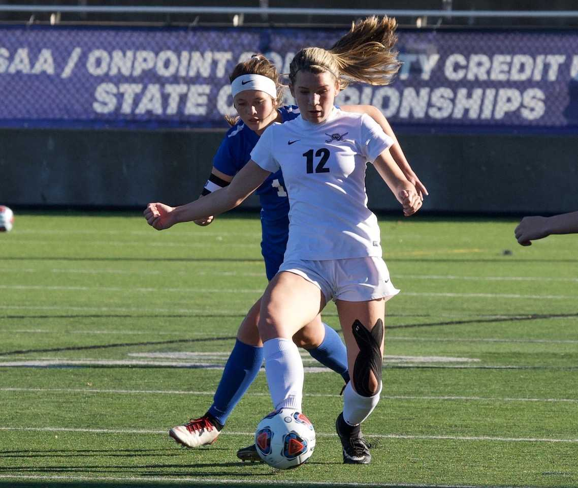 Crescent Valley's Ana McClave (12) scored two goals, including the winner in overtime. (Photo by Norm Maves Jr.)