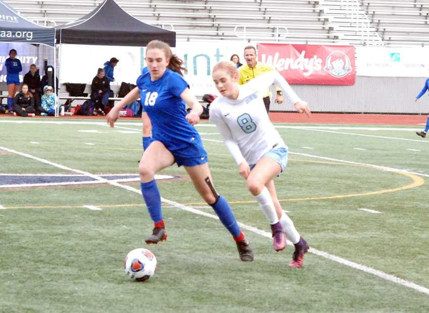 Sophia Spry (18) of Catlin Gabel and Stephanie Filnley of OES work for possession in the OSAA 3A/2A/1A soccer final on Saturday