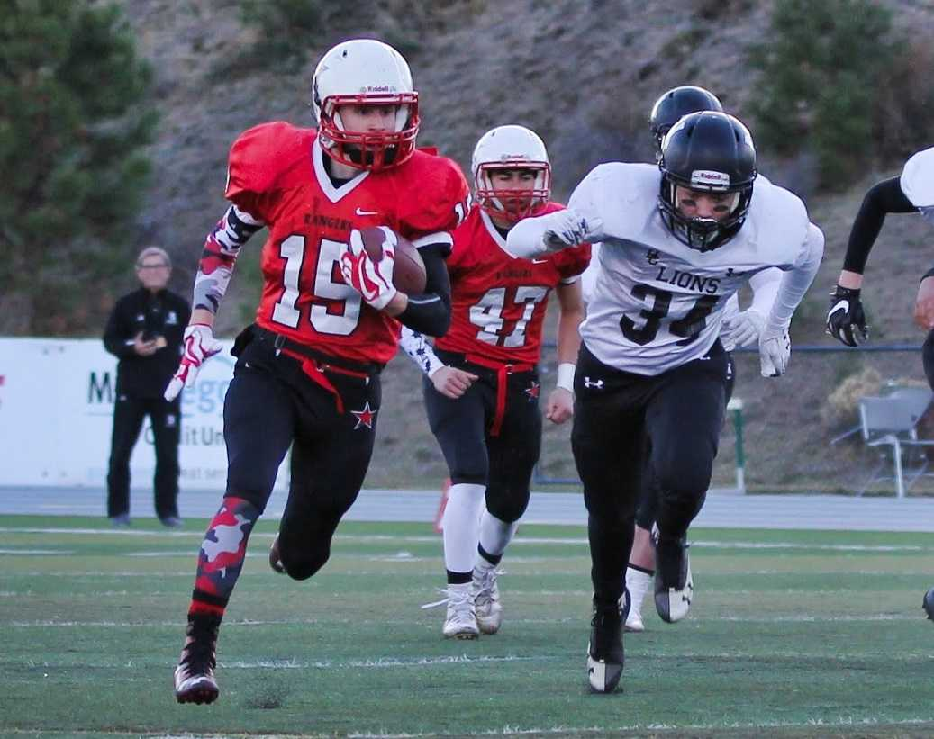 Dufur's Tanner Masterson ran for four touchdowns and caught a scoring pass Saturday. (Photo by Robert Wallace)