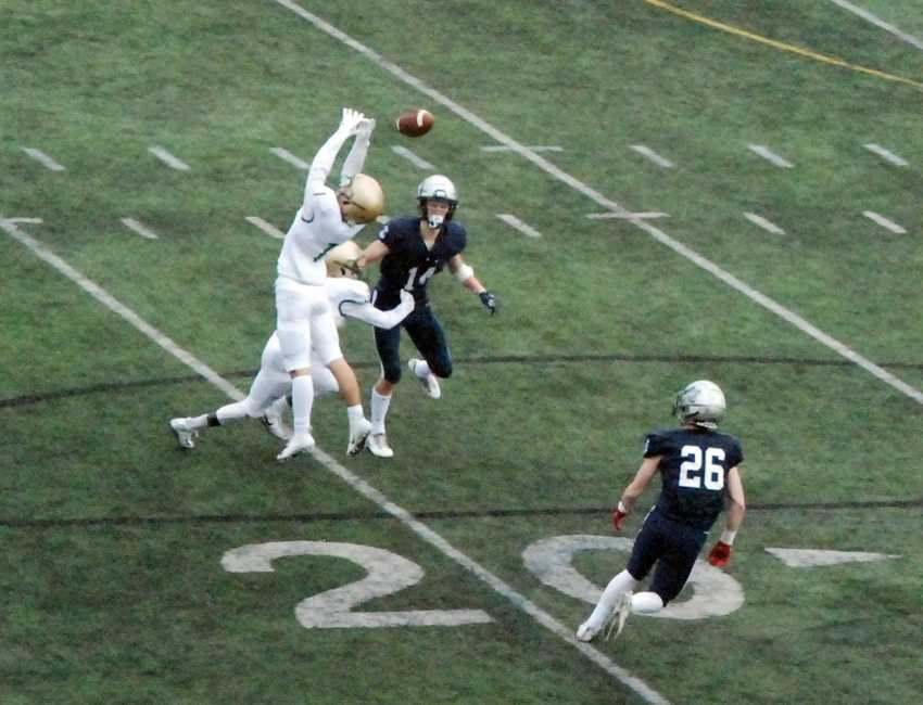 Jesuit corner Campbell Brandt tips this Jackson Laurent pass, which found the waiting arms of Jack O'Brien (26) for an LO score