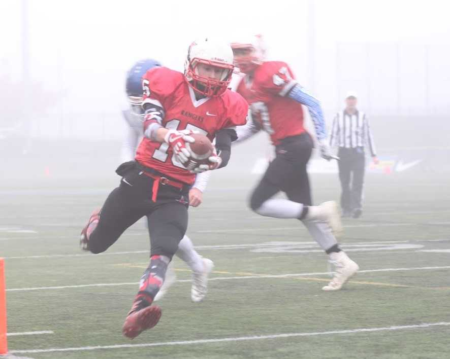 Dufur's Tanner Masterson scored on a run and an interception return against St. Paul. (Photo by Robert Wallace)