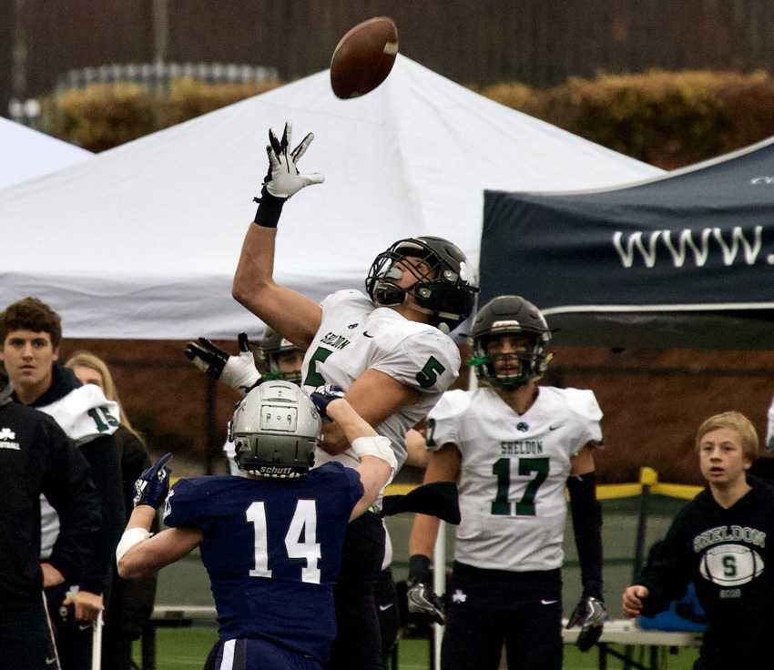 Patrick Herbert hauls in the 43-yard pass late in the fourth quarter to give Sheldon a chance. Photo by Norm Maves, Jr.