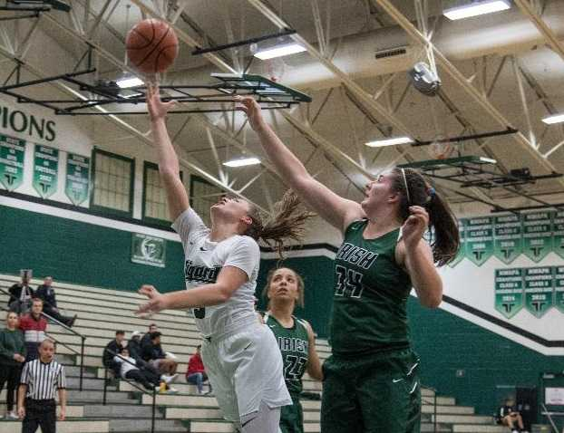 Tigard's Campbell Gray goes up for a shot against Sheldon's Emma Neuman (34). (Photo by Ralph Greene)