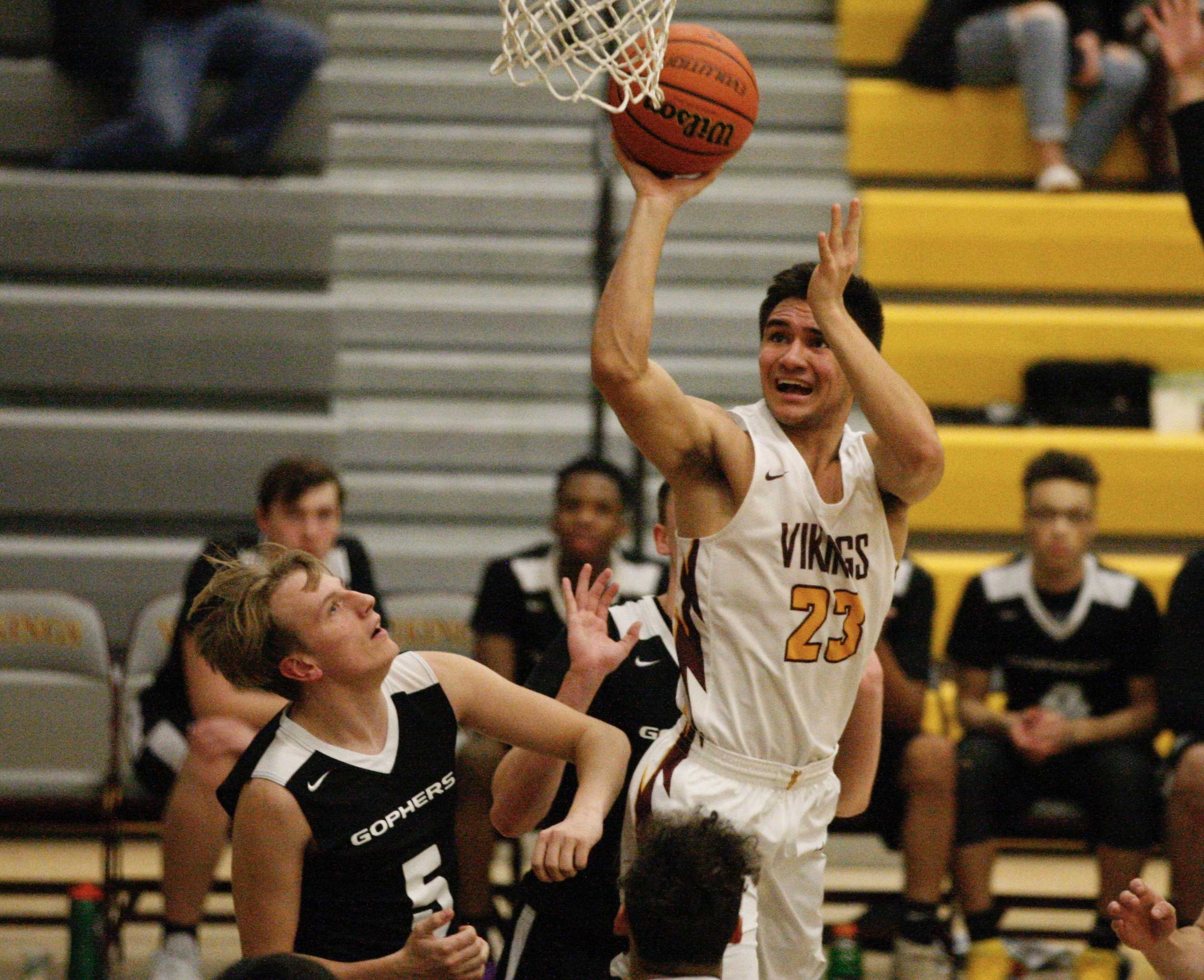 Forest Grove's Guy Littlefield drops a short shot in the key on his way to 20 points Friday. (Photo by Norm Maves Jr.)