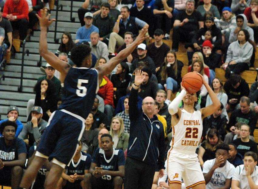 Isaiah Amato fires from long range for Central Catholic, which scored 27 points against University from behind the arc