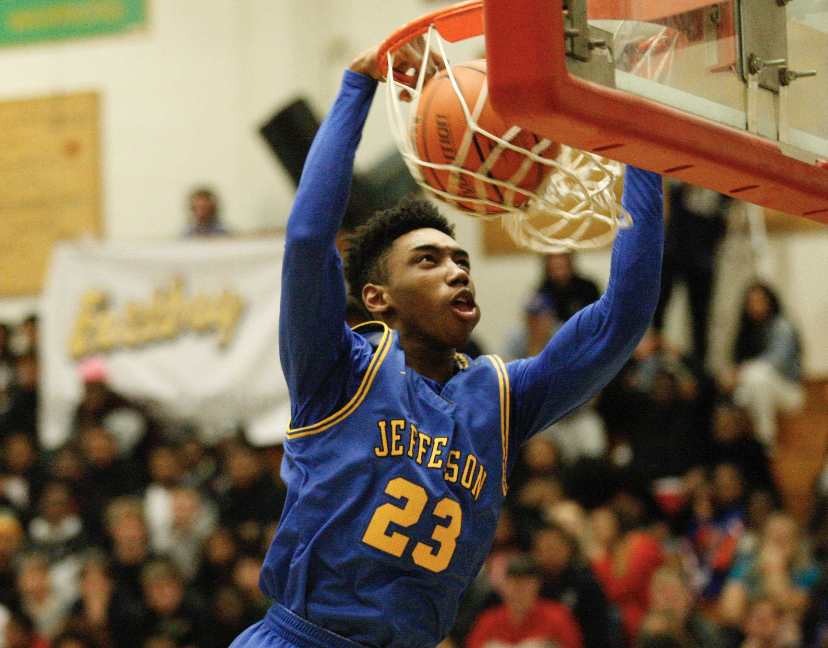 Jefferson's Jonathon Nchekwube slams in the last two points of the first quarter for the Democrats on Saturday night.