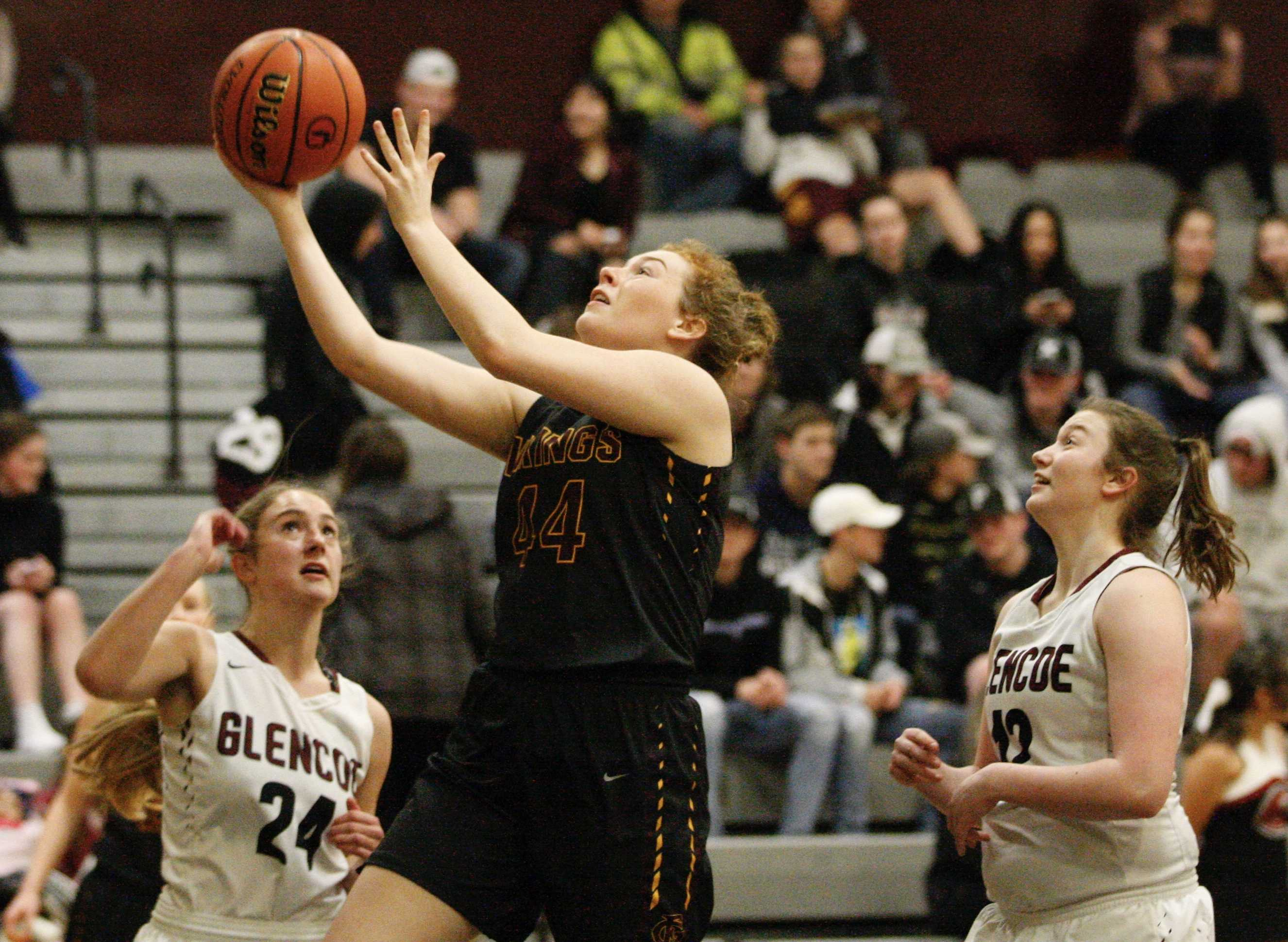 Forest Grove's Olivia Grosse gets between Breauna Van Dyke and Briana Ball of Glencoe for two of her nine points.