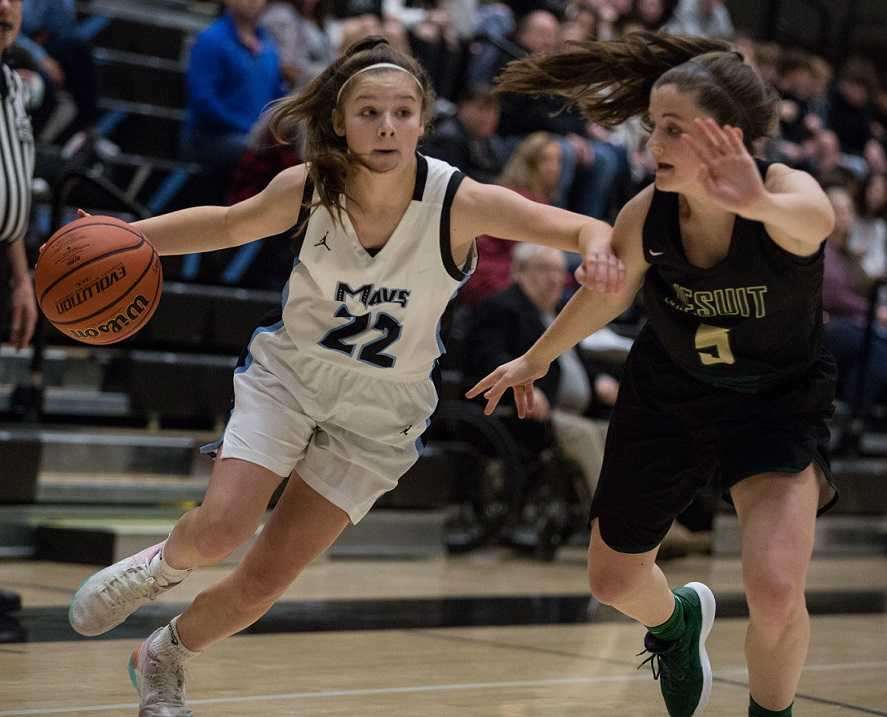 Halle Hageman, driving against Jesuit's Anna Fanelli, leads Mountainside in scoring with a 17.0 average.
