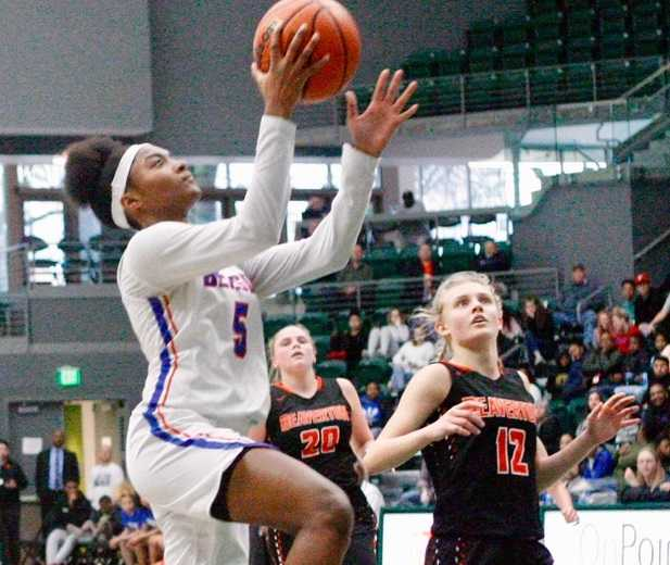 Benson's Tayler Lyday beats Beaverton's Mary Kay Naro (12) for two of her game-high 19 points. (Photo by Norm Maves Jr.)