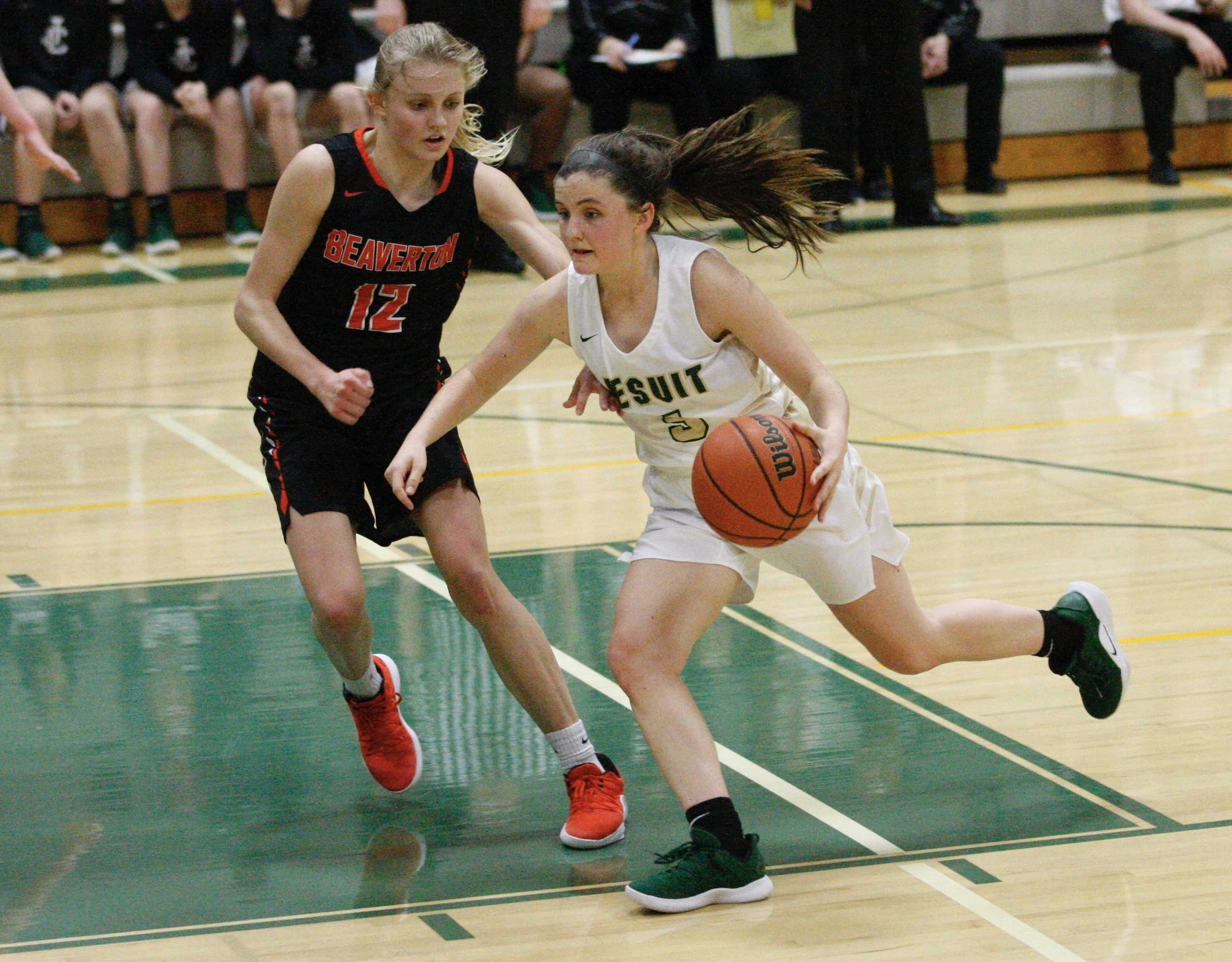 Jesuit guard Anna Fanelli drives on Beaverton's Mary Kay Naro on Wednesday night. (Photo by Norm Maves Jr.0