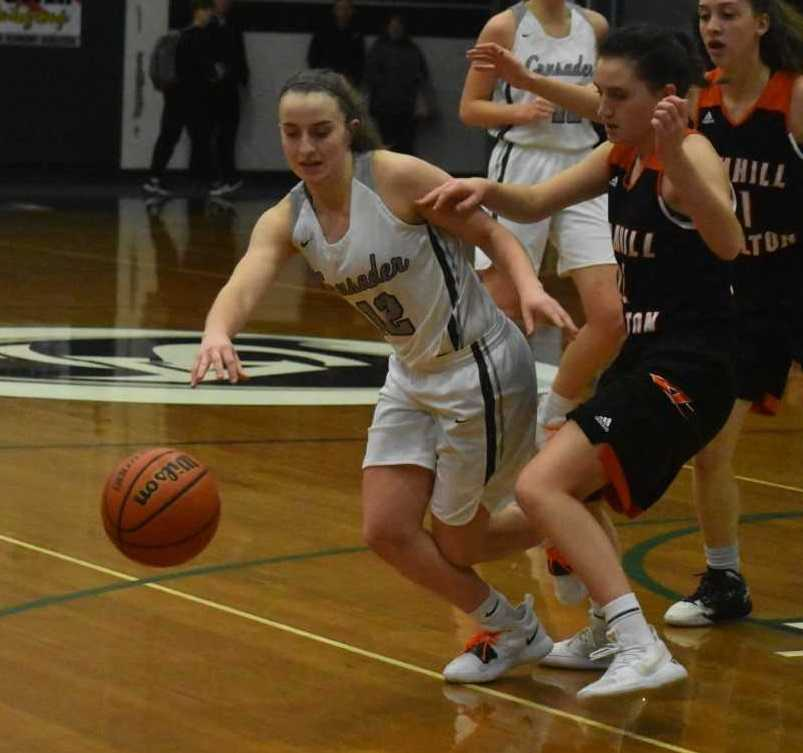 Salem Academy's Kirsten Koehnke (left) chases a loose ball against Yamhill-Carlton's Olivia Southard. (Photo by Jeremy McDonald)