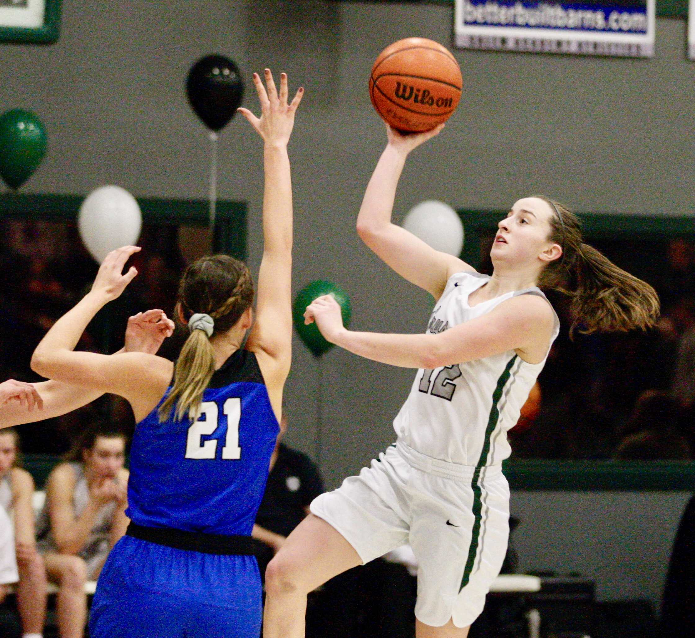 Salem Academy's Kirsten Koehnke drives past Blanchet Catholic's Hailey Ostby for two of her game-high 23 points.