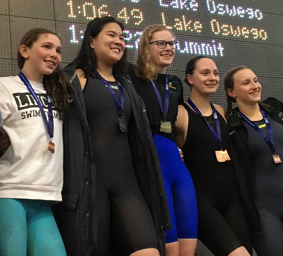 Aloha's Kaitlyn Dobler (center) with the other finalists from the 100 breaststroke.