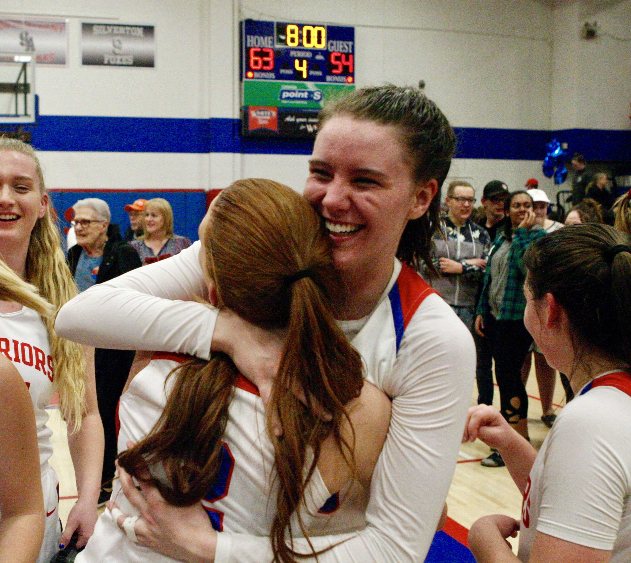 Lebanon's Ellie Croco is all smiles as she hugs teammate Maddy Romeo after the victory over Crescent Valley.